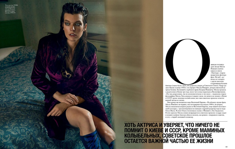 Milla Jovovich poses in Dior coat and Kenzo boots