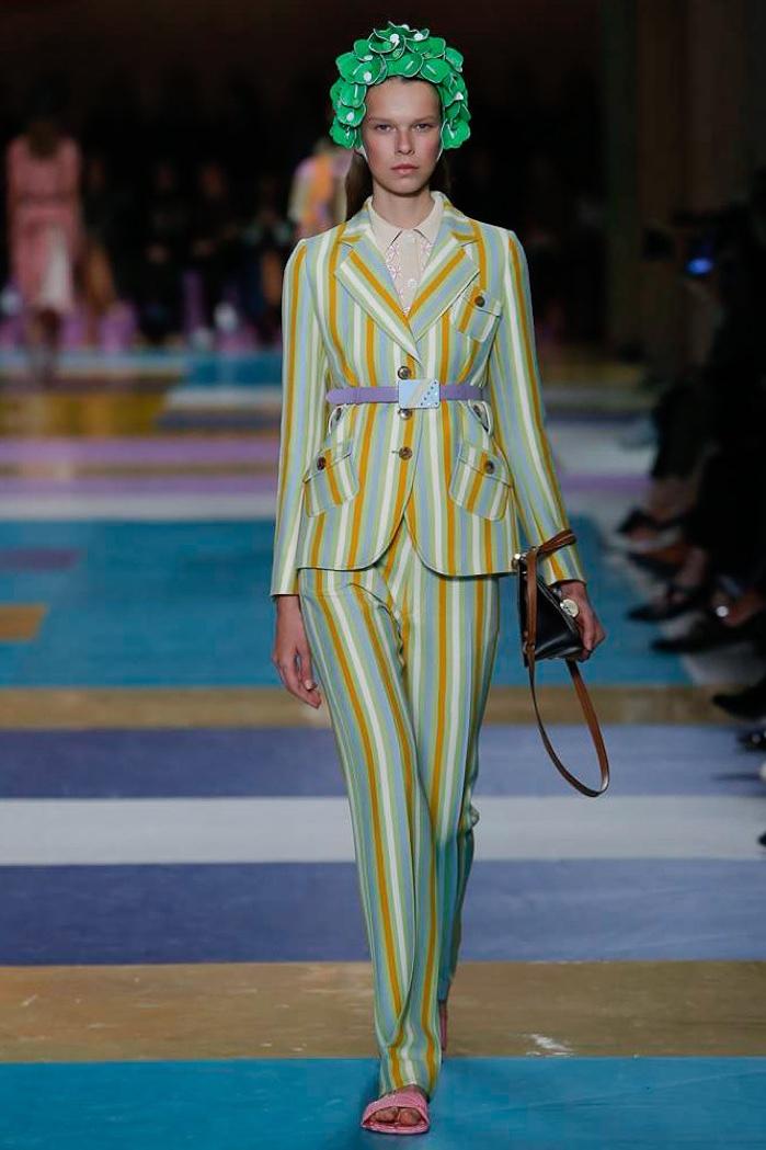 Miu Miu Spring 2017: Model walks the runway in striped jacket and pants