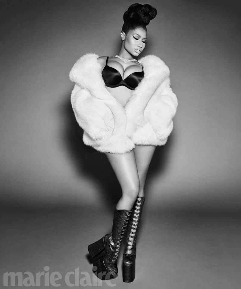 Rapper Nicki Minaj poses in bra, fur coat and Marc Jacobs platform boots