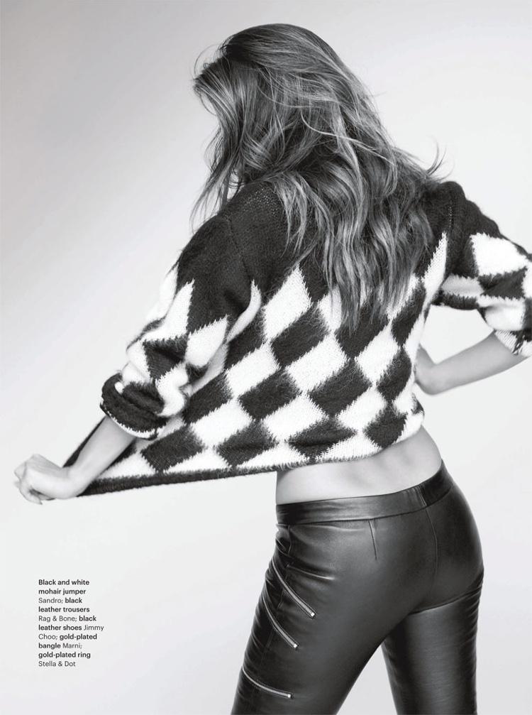 Nicole Scherzinger poses in Sandro sweater with Rag & Bone leather pants