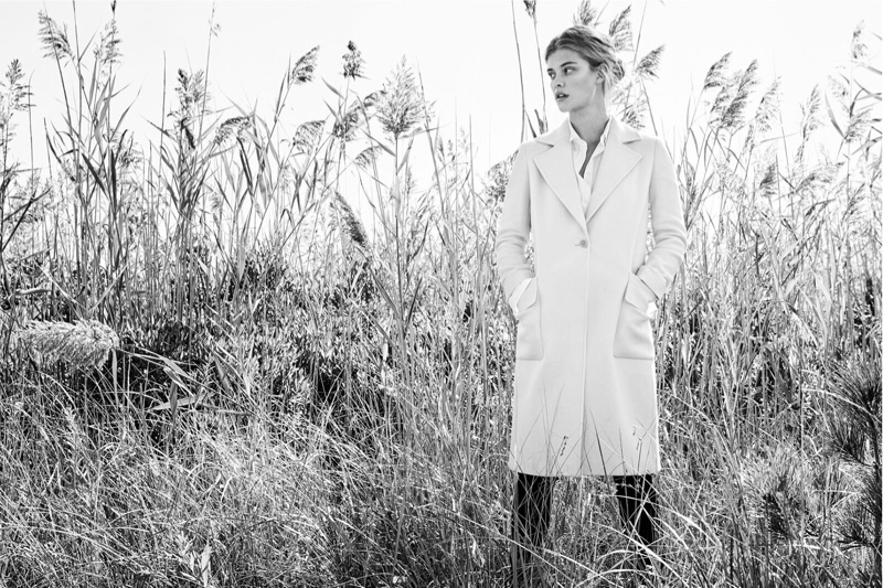 Model Nina Agdal covers up in a Massimo Dutti coat