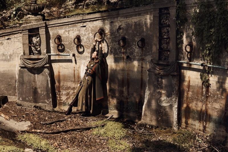 Rebecca Hall poses in Burberry Cape, Ellery corset, Ganni dress and Prada belt