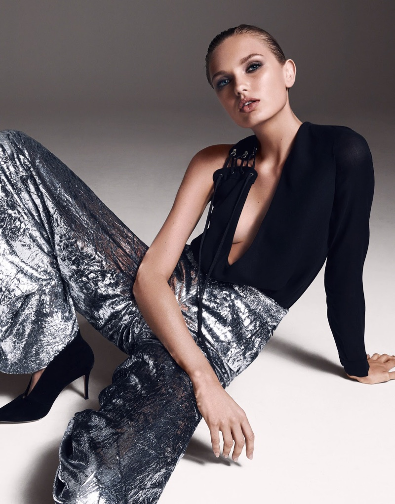 Lounging, the model poses in Anthony Vaccarello top with Delpozo pants and Gianvito Rossi shoes