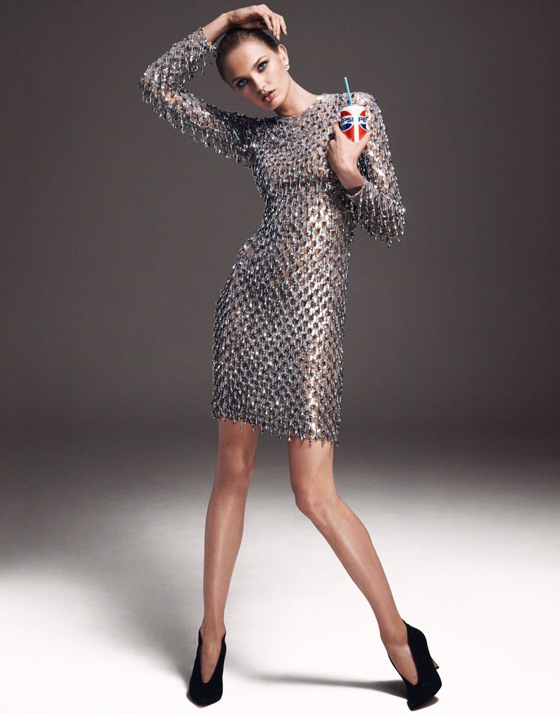 Posing with a can of coke, Romee Strijd shines in Michael Kors dress with Gianvito Rossi heels