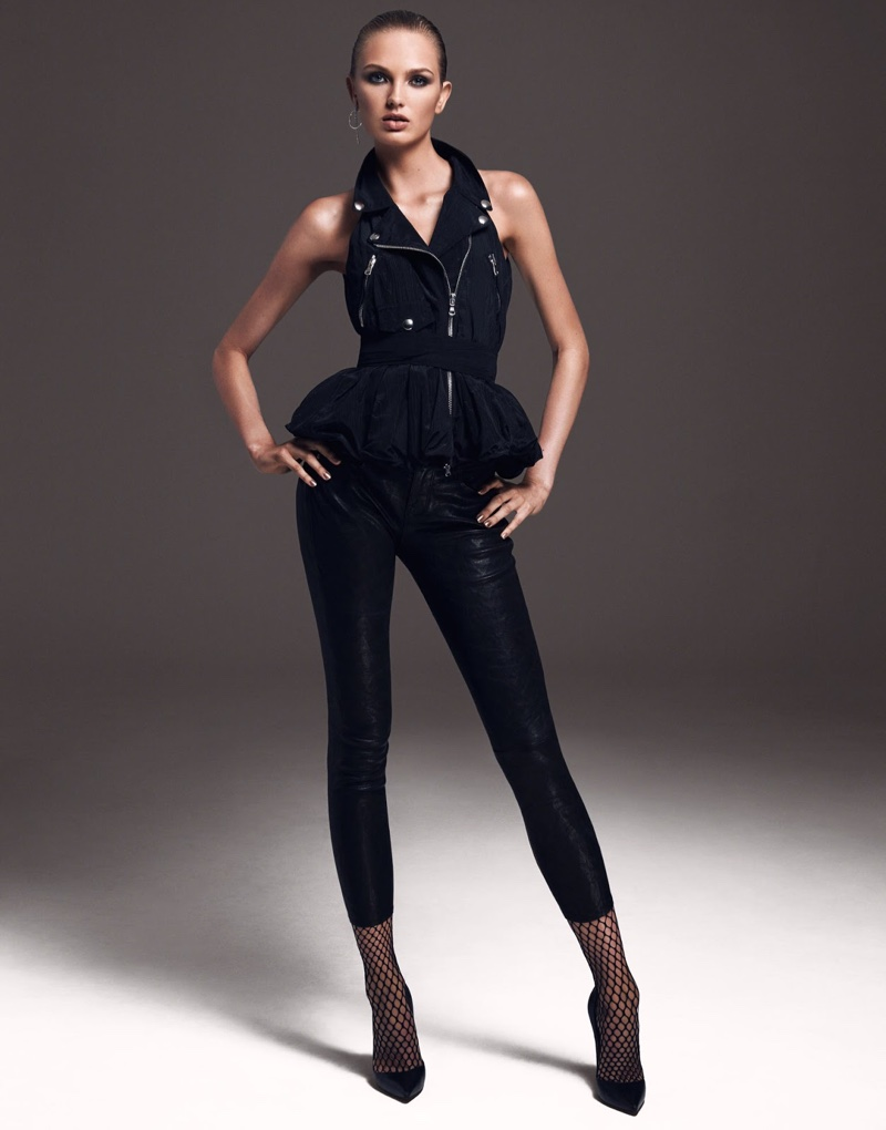 Clad in all black, Romee Strijd wears Moschino top, Frame pants and Christian Louboutin pumps