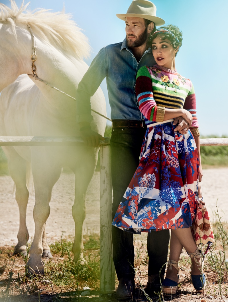 Posing next to a white horse, actress Ruth Negga poses in a Gucci sweater and skirt