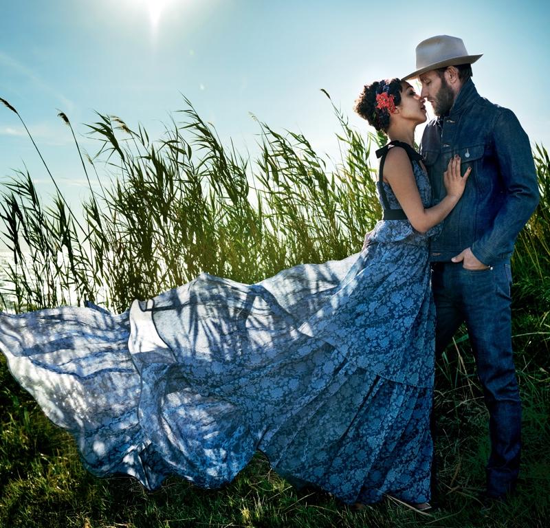 Sharing an embrace with her co-star, Ruth Negga wears an Erdem printed maxi dress. Photo: Vogue/Mario Testino