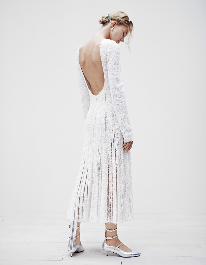 Sasha Luss models white dress with silver heels