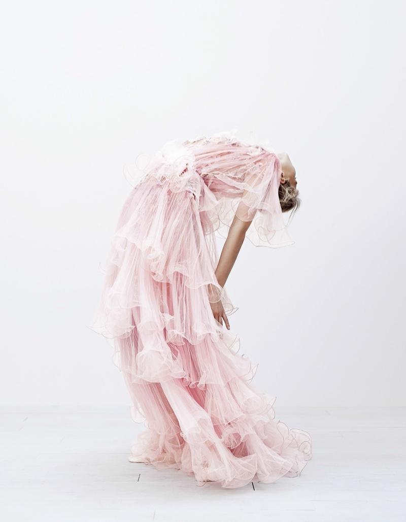 Model Sasha Luss strikes a pose in pink ruffle adorned dress