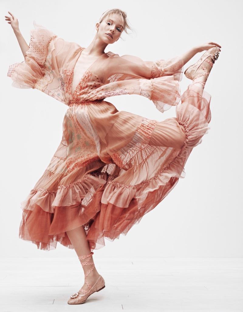 Taking a leap, Sasha Luss models printed dress