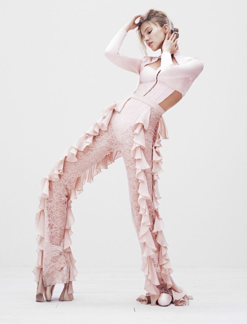 Looking pretty in pink, Sasha Luss models Balmain top and ruffle-decorated pants