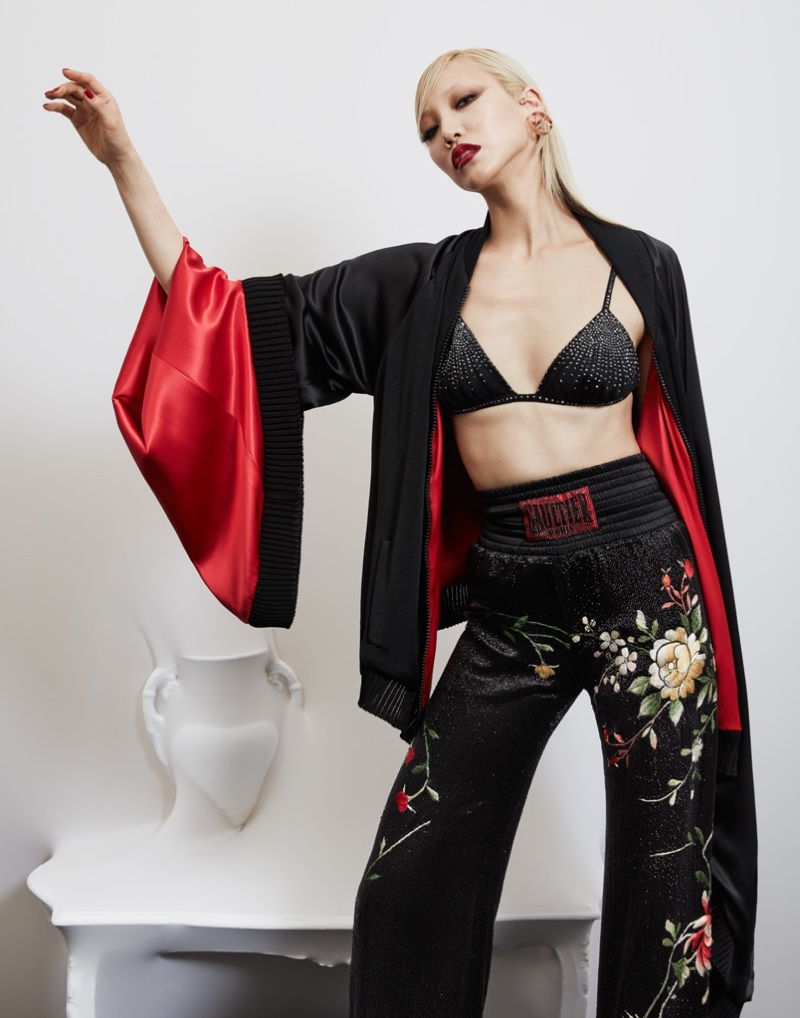 Model Soo Joo Park wears kimono sleeve jacket with floral embroidered pants