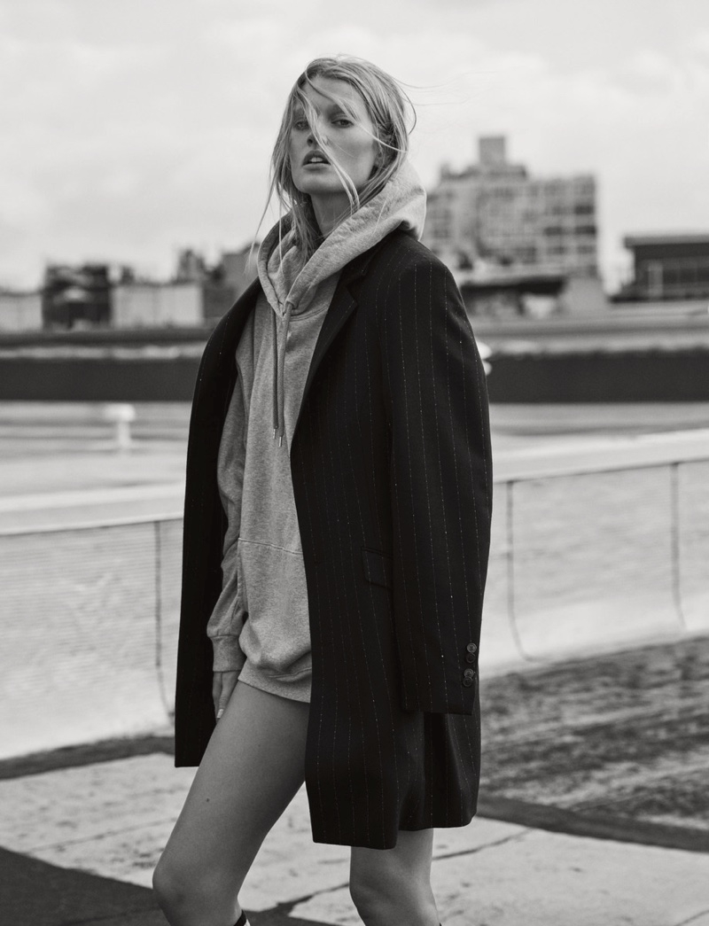 Layering up for cold weather season, Toni Garrn wears Hugo coat and sweater