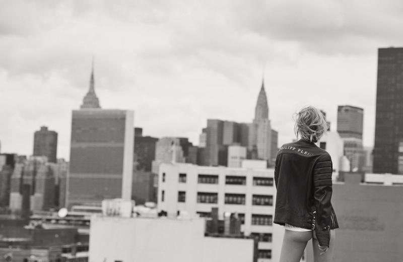 Toni Garrn flaunts her bum in Calvin Klein Collection t-shirt and Philipp Plein leather jacket