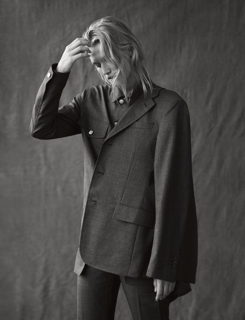 Photographed in black and white, Toni Garrn wears Louis Vuitton jacket, shirt and pants