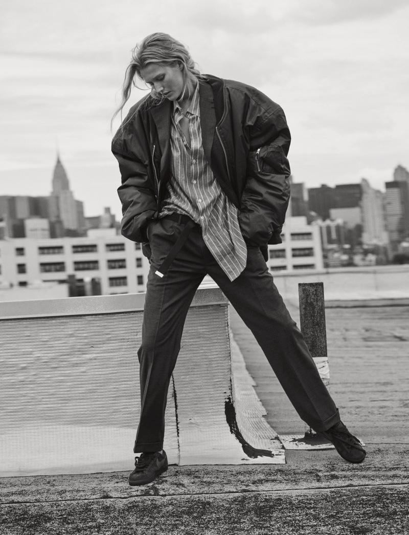 Posing outdoors, Toni Garrn models Vetements bomber jacket with Nike sneakers