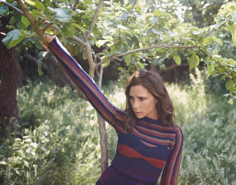 Posing outdoors, Victoria Beckham wears sweater and bandeau top from Victoria Beckham