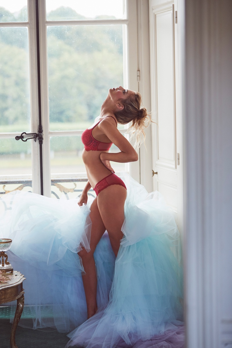Stella Maxwell wears Beautiful by Victoria's Secret Unlined Uplift Lace Bra