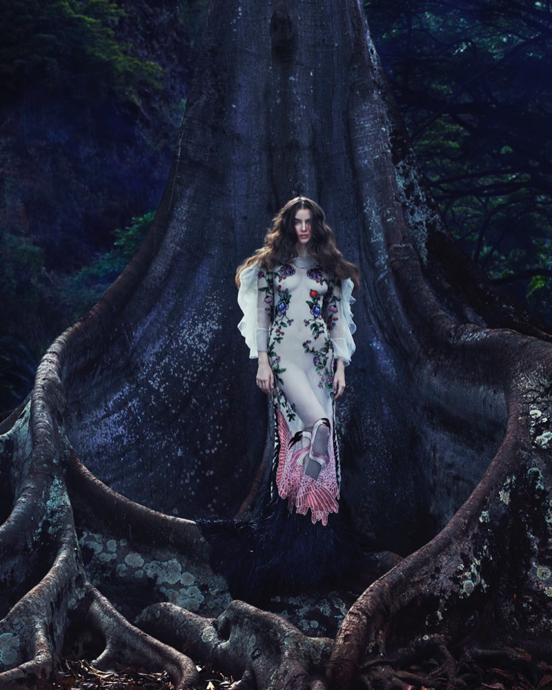Looking ethereal, the model poses in a Gucci embroidered dress with feathers