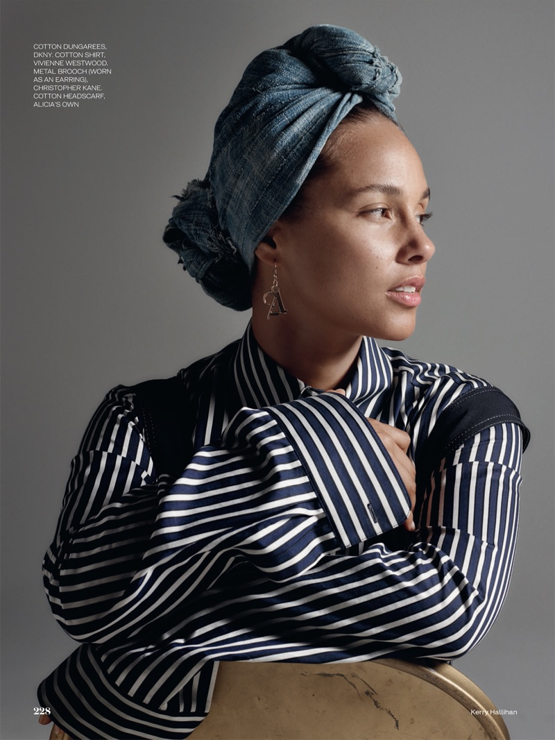 Singer Alicia Keys models DKNY overalls, Vivienne Westwood striped shirt and cotton scarf