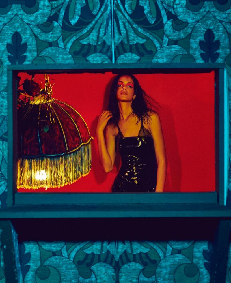 Amanda Wellsh poses in black latex dress