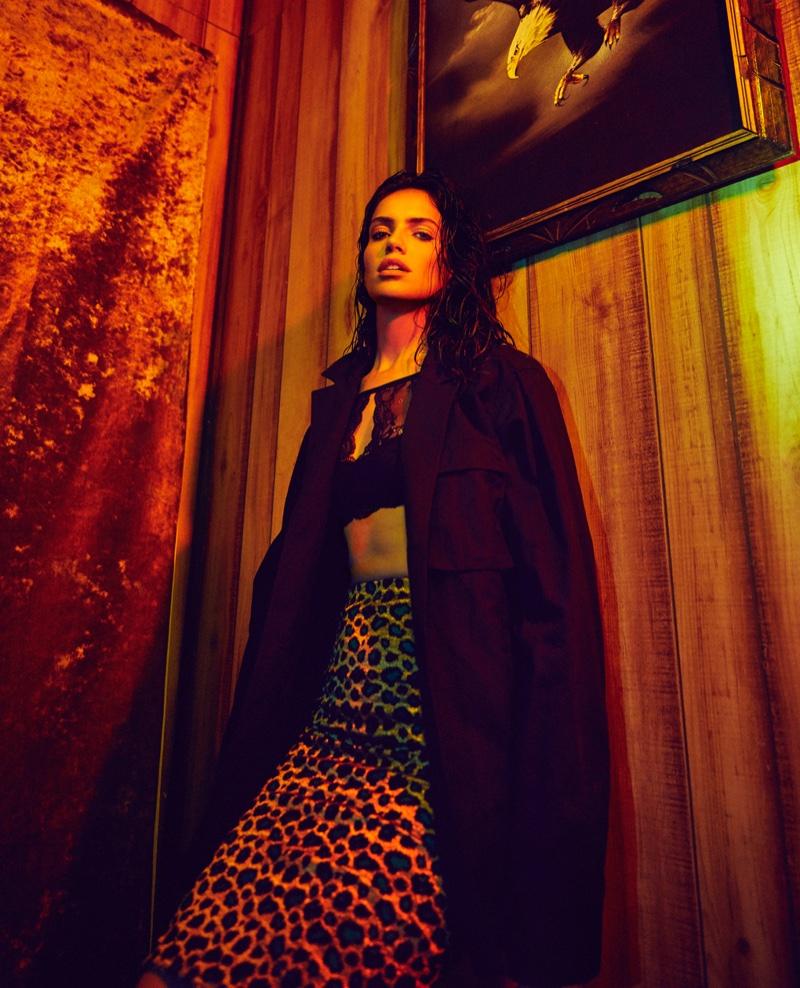 Amanda Wellsh wears black coat lace bralette and leopard print skirt