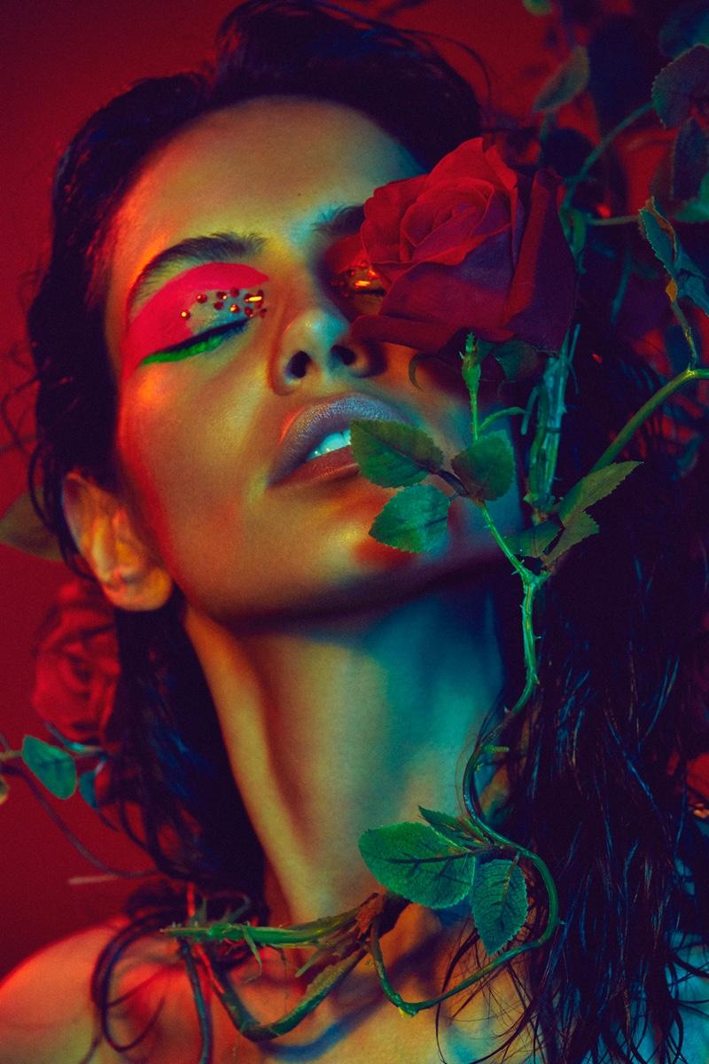 Amanda Wellsh wears red eyeshadow with crystal embellishments