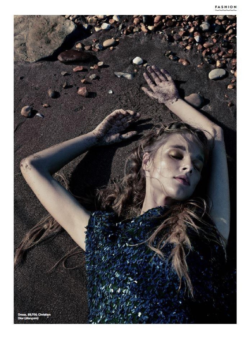Posing at the beach, Beegee Margenyte wears Dior embellished dress
