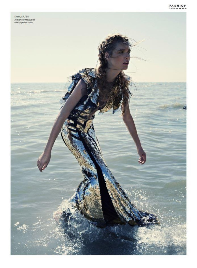 In the ocean, Beegee Margenyte models a silver sequined dress from Alexander McQueen