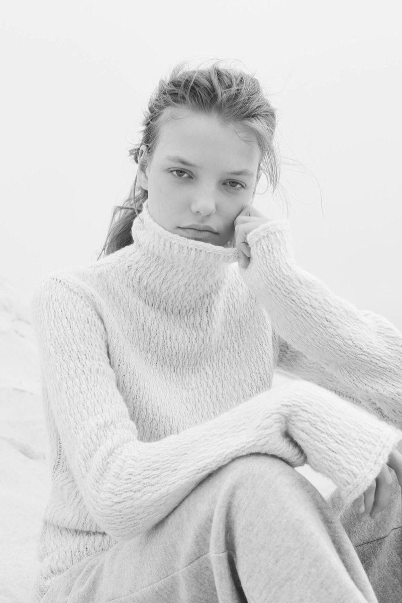 Model Roos Abels covers up in turtleneck cashmere sweater from Calvin Klein Collection