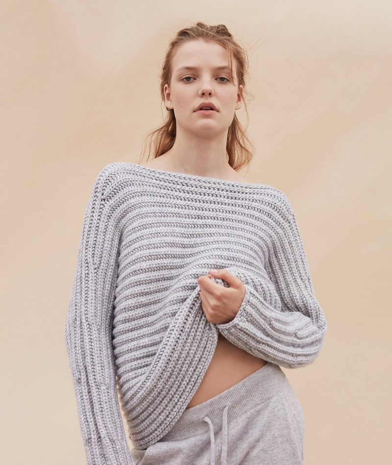 Roos Abels wears cashmere sweater from Calvin Klein Collection