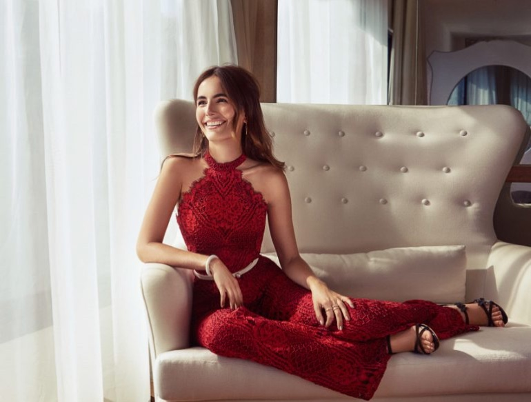 Actress Camilla Belle wears red lace jumpsuit
