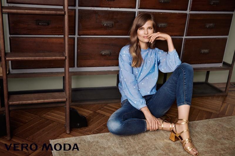 Caroline Brasch Nielsen wears blue long-sleeve top and blue jeans