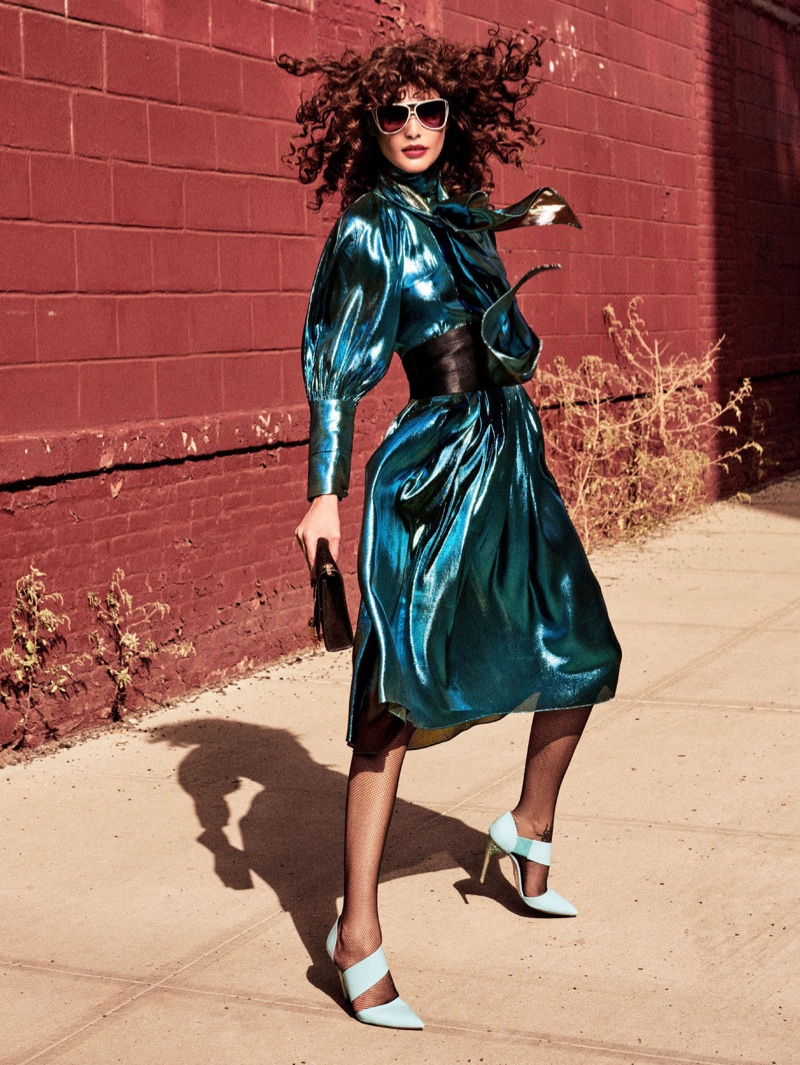 Bringing the shine factor, Catherine McNeil models Ellery blue metallic dress with patent-leather shoes by Blumarine