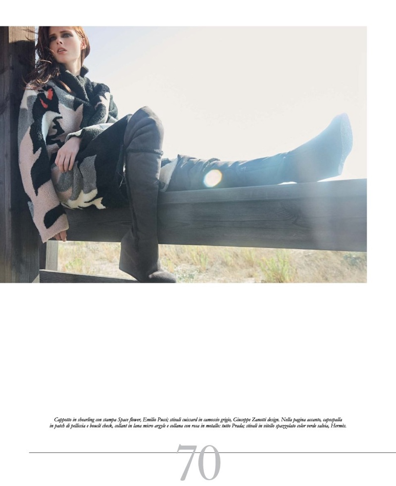 Sitting on a fence, Coco Rocha models Emilio Pucci shearling cape with Giuseppe Zanotti Design boots