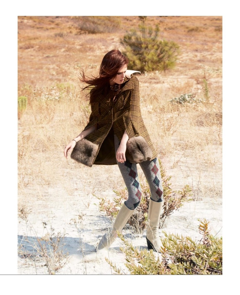 Striking a pose, Coco Rocha models a Prada jacket, wool tights and Hermes boots
