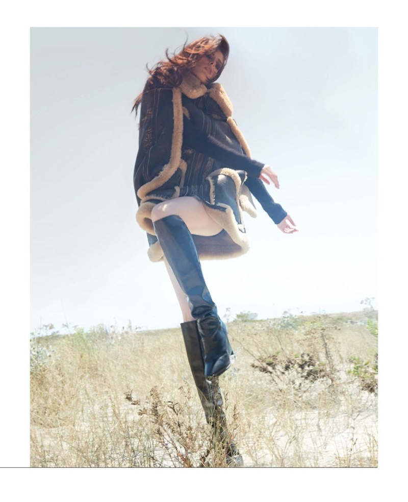 Striking a pose, Coco Rocha poses in Maison Margiela cape jacket and knee-high boots