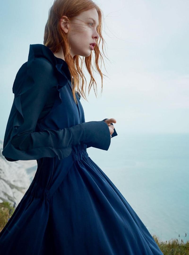 Dani Witt poses in silk dress with ruffles from Fendi