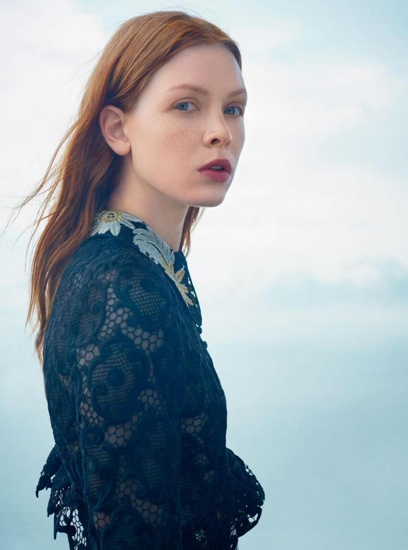The model wears a guipure dress from Erdem