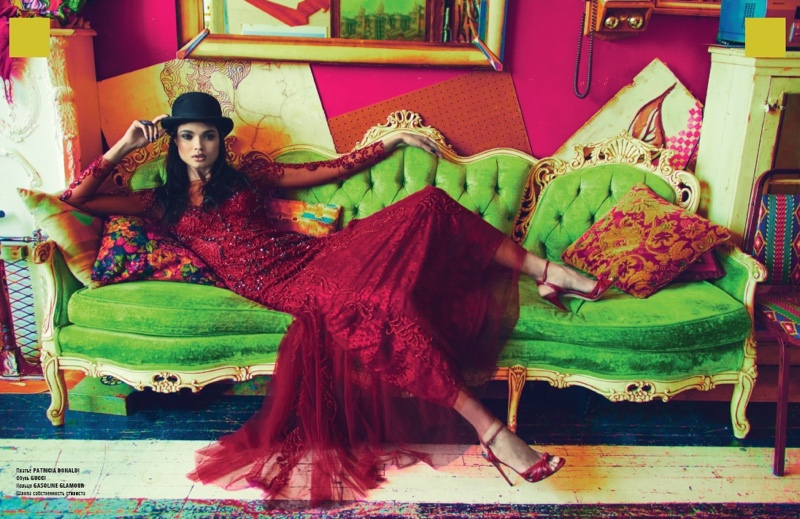 Lounging on a couch, Daniela Braga wears embellished Patricia Bonaldi gown