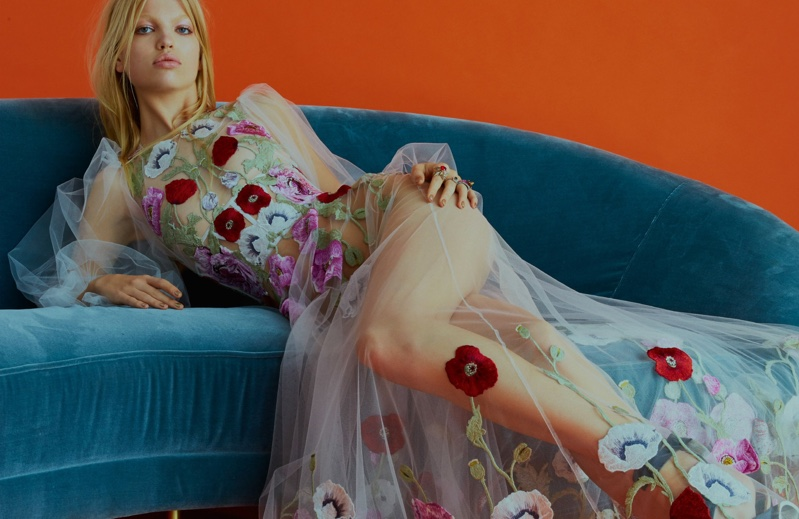 Model Daphne Groeneveld poses in sheer Alexander McQueen gown with embellishments
