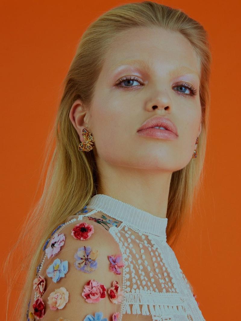 Getting her closeup, Daphne Groeneveld wears floral appliqué top