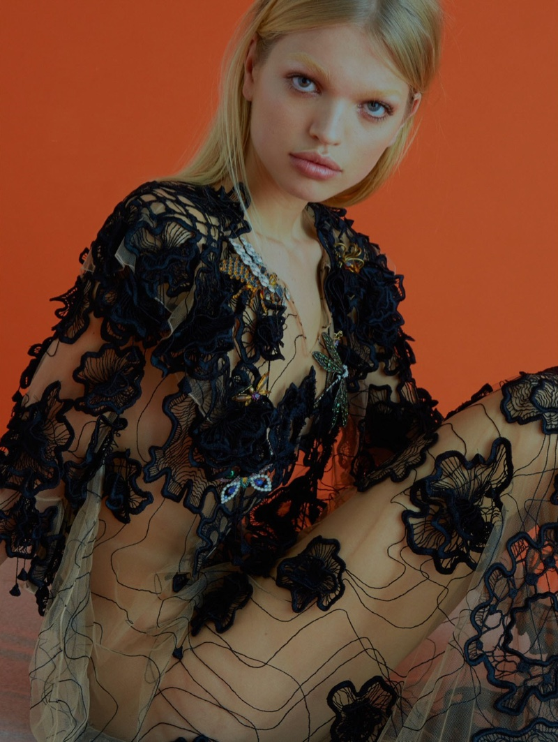 Clad in black and sheer gown, Daphne Groeneveld poses for ELLE UK