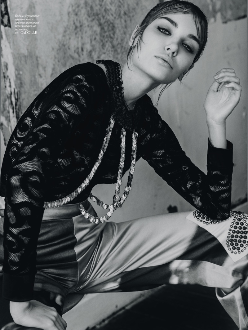 Photographed in black and white, Daria Konovalova wears Cadolle lace top and pants