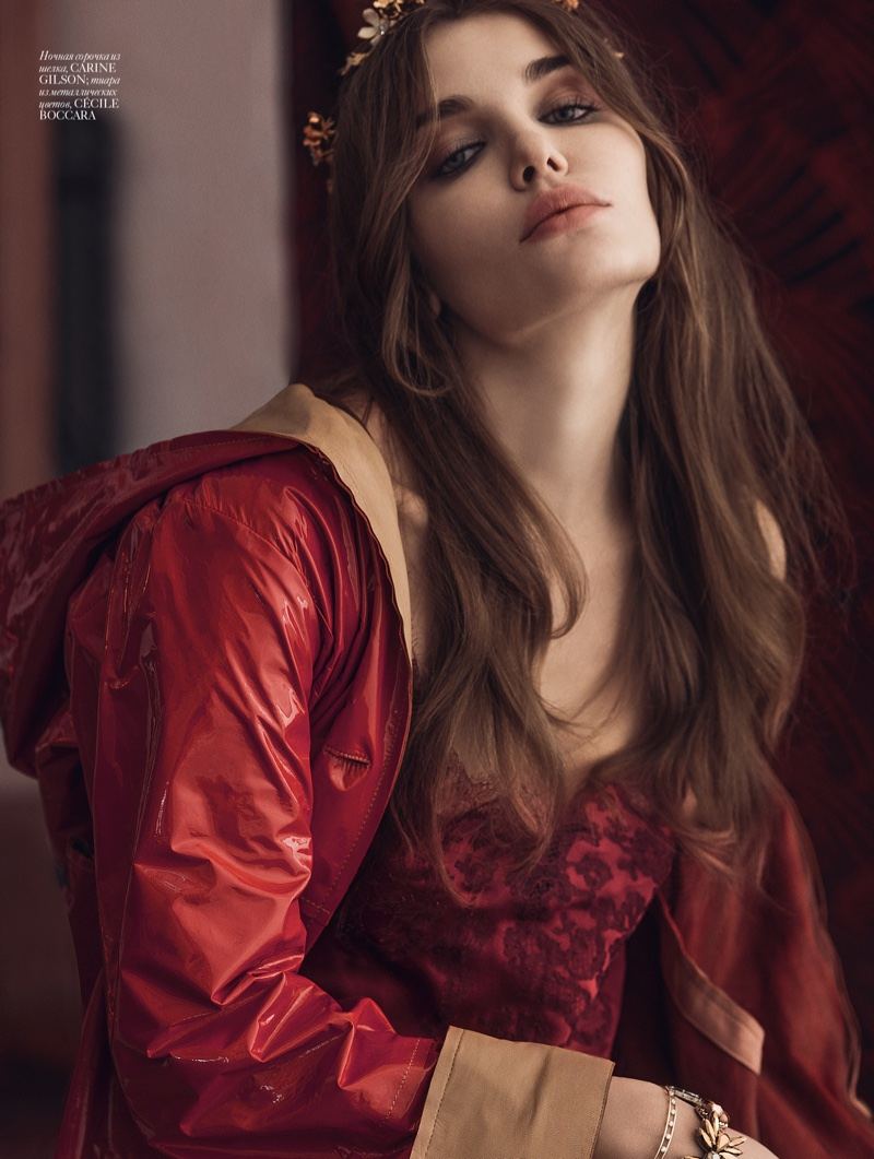 Looking lovely in red, the model poses in Carine Gilson jacket and dress with Cecile Boccara jewelry