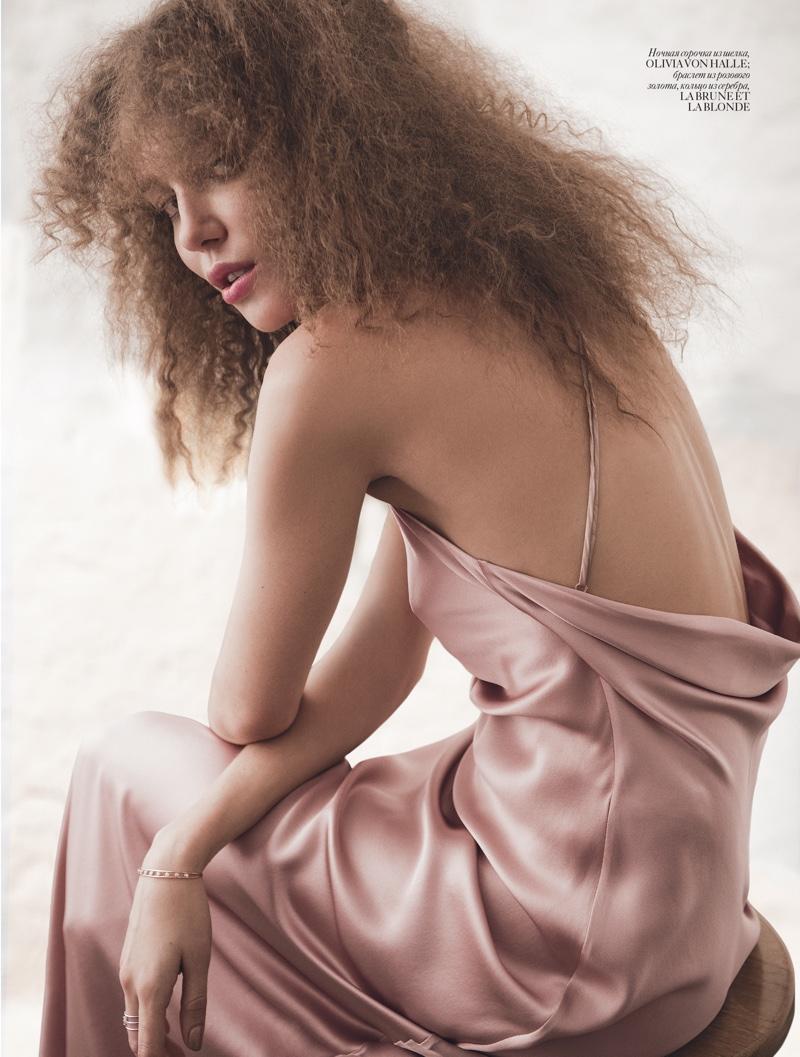 Daria Konovalova wears Olivia Von Halle silk slip dress