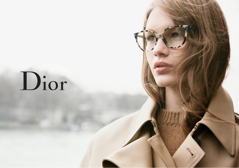Wearing a trench coat, Sofia Mechetner models a style from Dior Eyewear's fall-winter 2016 collection