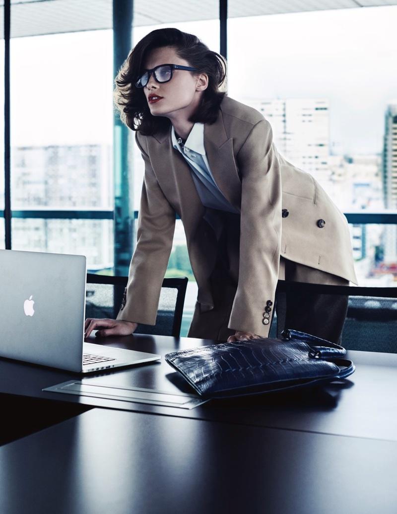 Elena Melnik wears Celine blazer, shirt and pants