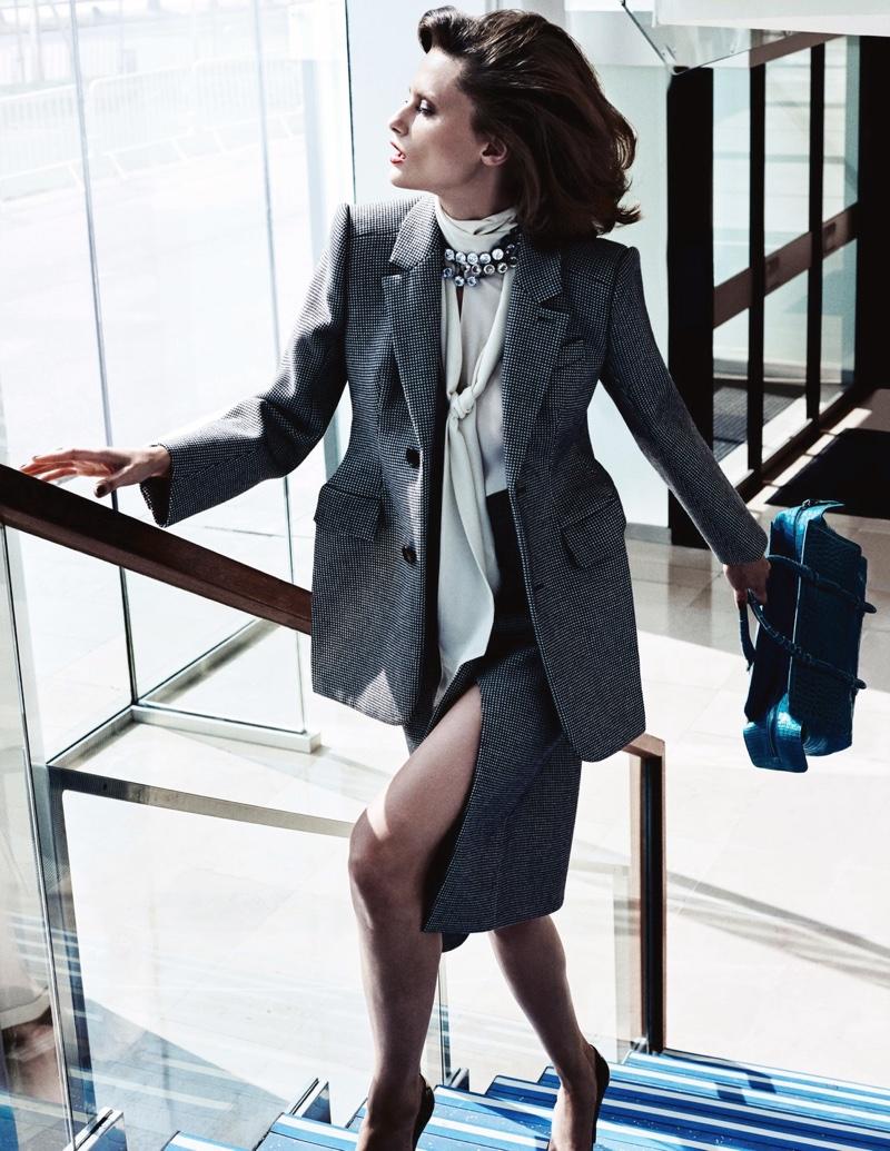 Elena Melnik takes a walk in Balenciaga suit jacket, blouse and skirt