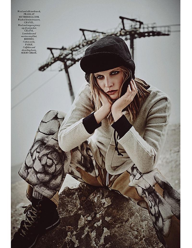 Staying covered up, Emma Menteath wears a Prada turtleneck, Chanel denim pants, Celine jacket and Hermes hat